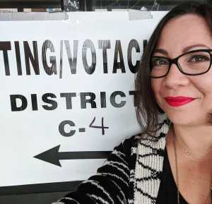 Red lips, blue ballot. Woman at a polling station.